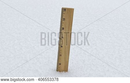 A Wooden Ruler Sticking Out Of The Snow Measuring Five Inches Of Snow Fall During A Storm.