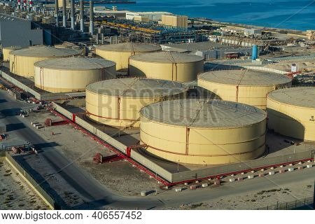 Middle East Water And Gas Containers Along The Coastline For Gas, Water And Oil Concepts. Industrial