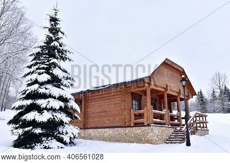 Wooden House In Forest In Winter Time. Log Cabin In The Forest Alone In Wilderness. Wooden House Wit