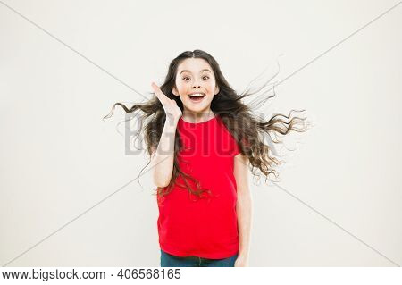 What A Happy Surprise. Surprised Girl On Yellow Background. Adorable Little Child With Surprise Emot
