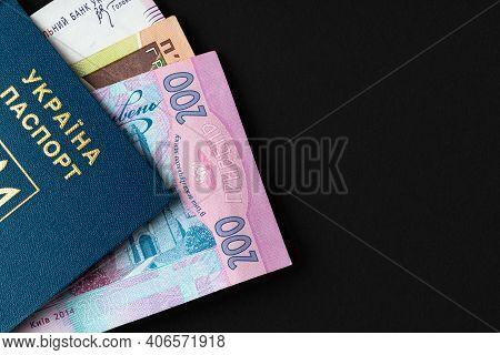 Ukrainian Hryvnia Banknotes In Ukrainian Passport Close Up