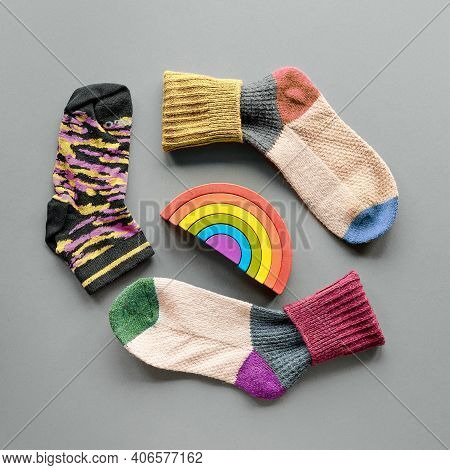 Odd Socks Day. Mismatched Socks And Rainbow Toy. Social Initiative Against Bullying In School Or Wor