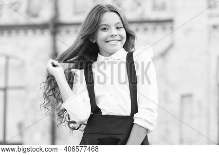 Delight In The Details. Girl Has Curly Hair. Little Girl Wear Classy Uniform. Back To School. Modern
