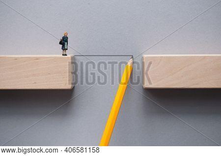 Pencil Sketch Bridging The Gap Between Wooden Blocks For Female Miniature Figure To Cross