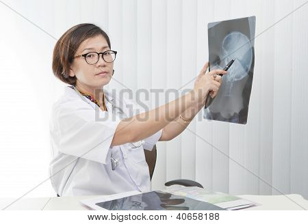 female doctor sitting in her working room with smiling face
