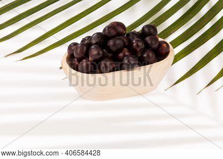 Bowl Wooden With The Amazon Acai Fruit (euterpe Oleracea).
