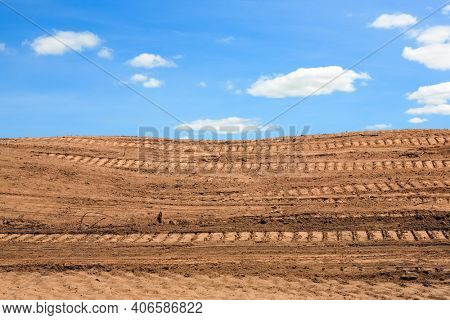 Dirt with tire tracks from heavy equipment developing land