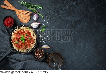 Pasta With Thick Sauce In A Frying Pan On A Black Background.