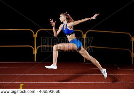 Sprinter Girl Jumps On Track Running Training