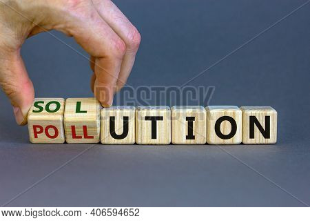 The Solution To Pollution Symbol. Male Hand Flips Wooden Cubes And Changes The Word 'pollution' To '