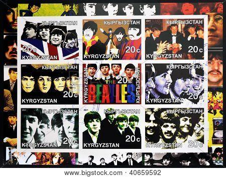 KIRZIGUISTAN - CIRCA 2001: Francobolli collezione stampato in spettacoli Kirziguistan i Beatles circa 2001