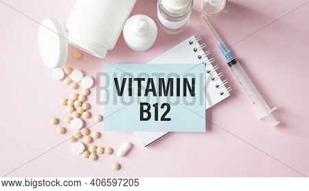 Notebook Page With Text Vitamin B12 On A Table With A Pills And Pencil, Medical Concept, Top View