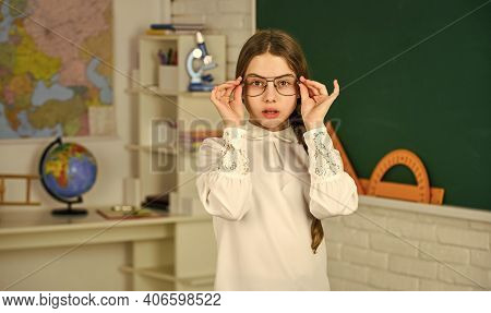 Geography Man On Wall. Small Child Girl Posing In School At Lesson. Learning Different Subjects. Bac