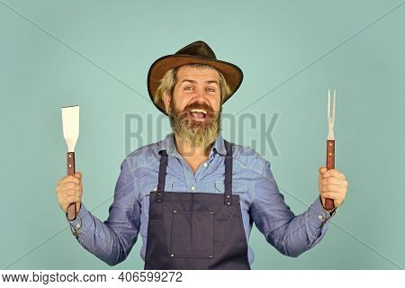 Farmer Promoting Bbq Equipment. Cooking Steak. Cooking Utensils. Summer Picnic. Bbq American Traditi