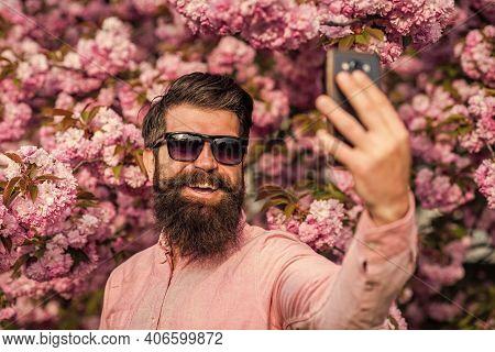 Personal Blog. Selfie With Sakura. Man Taking Selfie Photo Smartphone. Streaming Online Video Call.