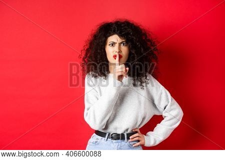 Angry Young Woman With Curly Hair And Red Lips, Frowning And Shushing, Tell To Be Quiet, Make Taboo