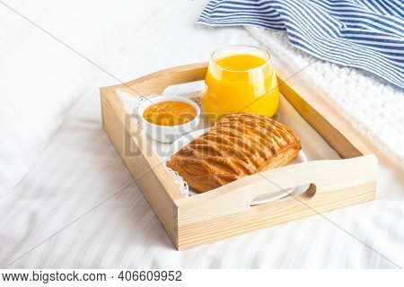 Breakfast In Bed With Puff Pastry, Orange Juice And Jam On Wooden Tray. Good Morning Concept.