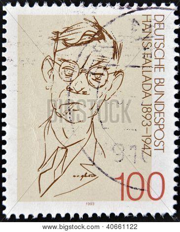 stamp printed in Germany shows to Rudolf Friedrich Wilhelm Ditzen ( Hans Fallada)