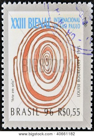 A stamp printed in Brazil shows the 23 International Biennial of Sao Paulo painting of Louise Bourge