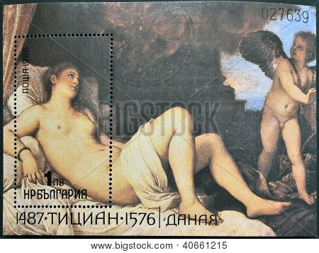 A stamp printed in Bulgaria shows Titian Vecelli painting Danae receiving the shower of gold