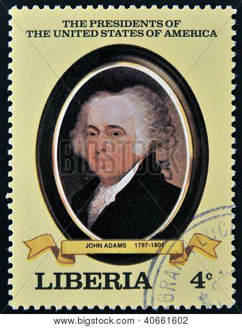 A stamp printed in Liberia shows President John Adams circa 1982