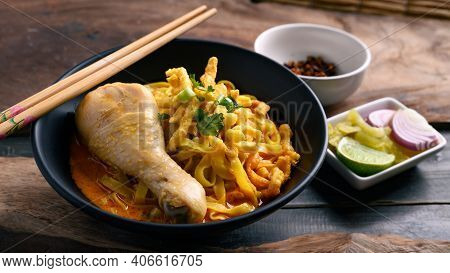 Northern Thai Food (khao Soi), Spicy Curry Noodles Soup With Chicken Eating With Crispy Deep-fried E