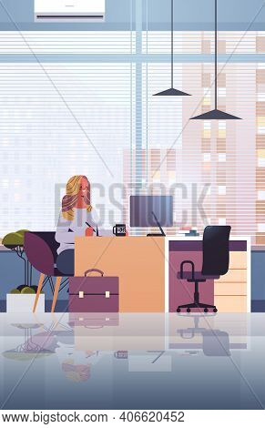 Young Businesswoman Sitting At Workplace And Using Computer Businesswoman Working In Office Vertical