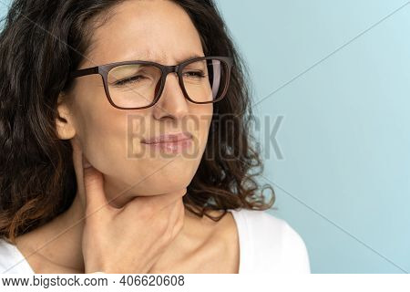 Closeup Of Sick Woman Wear Glasses Having Sore Throat, Tonsillitis, Caught Cold, Suffering From Pain
