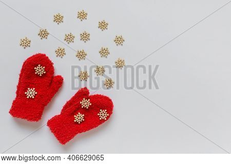 Little Red Kids Mittens With Many Small Wooden Decorative White Snowflakes And Copy Blank Space On W