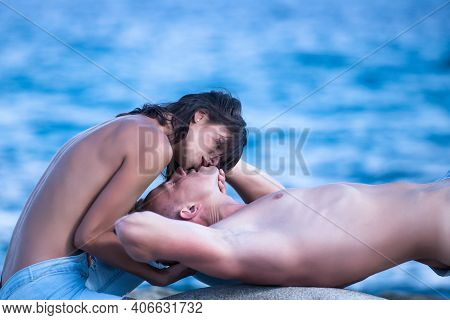 Summer Couple. Sexy Woman And Man Kissing. Love Relations Of Naked Couple At Sea Water On Beach. Hol
