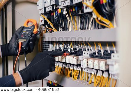Electrician Engineer Work Tester Measuring Voltage And Current Of Power Electric Line In Electical C