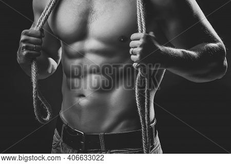 Muscular Man With Rope. Sexy Strong Young Man With Muscular Body