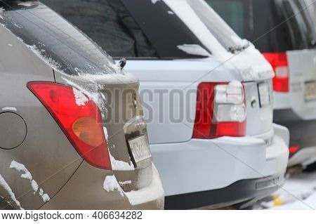 12.05.2020 Syktyvkar, Russia, Open Car Parking With A Row Of Cars On The Background Of A Winter Urba