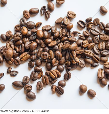 Brown Coffee Beans Lie On A Light Background. Food Ingredient. Web Banner.