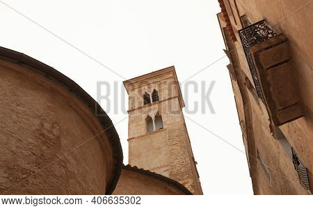 Bonifacio, Corsica. Street View With Eglise Sainte-marie-majeure De Bonifacio Under Bright Sky