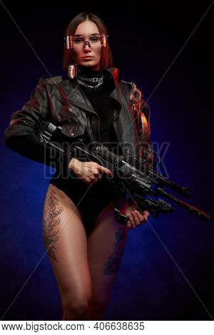 Martial And Futuristic Woman With Implant And Glasses Posing In Studio. Portrait Of A Attractive And