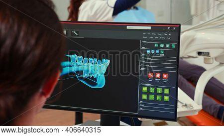Stomatologist Nurse Looking At Digital Dental Fingerprint On Computer Sitting In Stomatological Clin