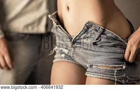 Body Part Sexy Jeans. Woman In Sexy Jeans Shorts. Sexy Woman Body In Jean Shorts. Sensual Couple. De