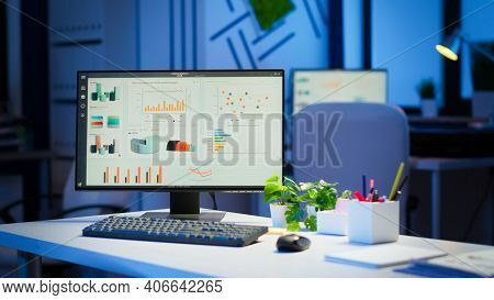 Interior Of Empty Start Up Business Office With Modern Design During Night With Graphics Running On