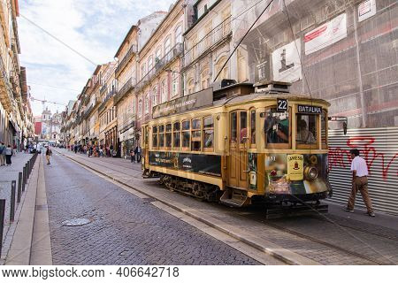 Porto, Portugal - October 06, 2018: Vintage Wooden Tram In City Centre Porto. Traditional Trams Ratt