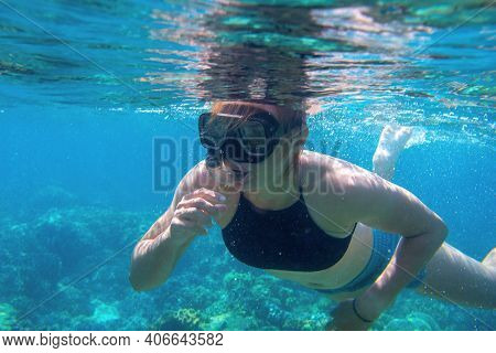 Woman Swimming In Blue Water. Young Woman Swimming On Sea Surface. Snorkel In Coral Reef Of Tropical