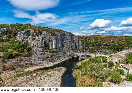 The Bridge Over The River Ardeche Near The Old Village Balazuc, Which Is Recognized As Historical He