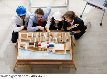Image Is Topview. A Man African American Engineering And Caucasian Holds Coffee. In Group Meetings V