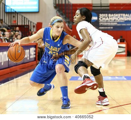 JAMAICA, NY-JAN 2: Delaware Blue Hens guard Lauren Carra (22) dribbles around St. John's Red Storm at Carnesecca Arena on January 2, 2013 in Jamaica, Queens, New York.