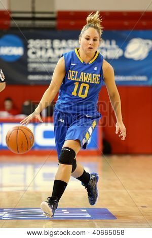 JAMAICA, NY-JAN 2: Delaware Blue Hens guard Kayla Miller (10) dribbles the ball against the St. John's Red Storm at Carnesecca Arena on January 2, 2013 in Jamaica, Queens, New York.