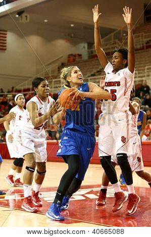 JAMAICA, NY-JAN 2: Delaware Blue Hens guard Elena Delle Donne (11) shoots as St. John's Red Storm guard Shenneika Smith (35) defends at Carnesecca Arena on January 2, 2013 in Jamaica, New York.
