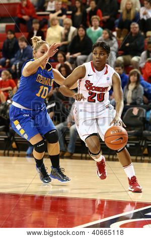 JAMAICA, NY-JAN 2: St. John's Red Storm guard Keylantra Langley (20) dribbles around Delaware Blue Hens guard Kayla Miller (10) at Carnesecca Arena on January 2, 2013 in Jamaica, Queens, New York.