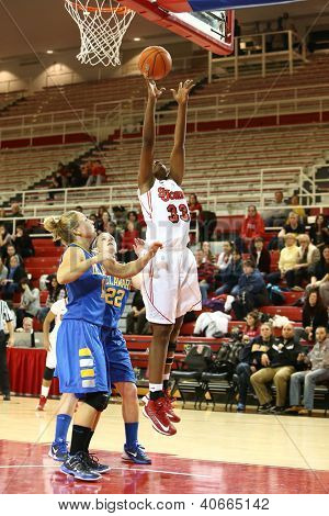JAMAICA, NY-JAN 2: St. John's Red Storm forward Sandra Udobi (33) goes up for a shot against the Delaware Blue Hens at Carnesecca Arena on January 2, 2013 in Jamaica, Queens, New York.