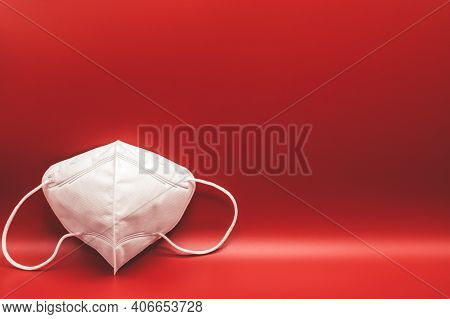Anti-pollution Mask On Red Background. Protection White Medical Face Mask For Epidemic Coronavirus Q