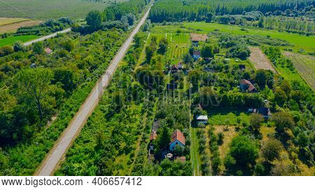 Aerial View Of Over Houses, Weekend Resort. Landscape, Several Cultivated Plots And Part Of Forest